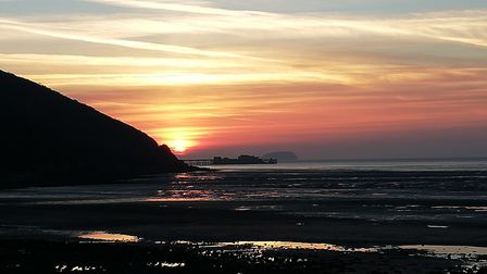 A peaceful image of the sunset at Sand Bay.