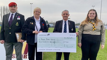 Members of the Royal British Legion receiving a cheque for £750.