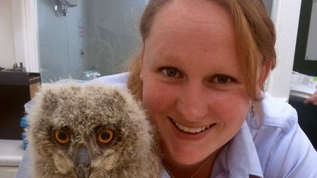 Sonya Miles with a baby owl at the rescue centre she runs with her husband.