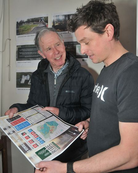 Grant George showing his designs for a cycle track to Cllrl Peter Colton. Picture: Jeremy Long