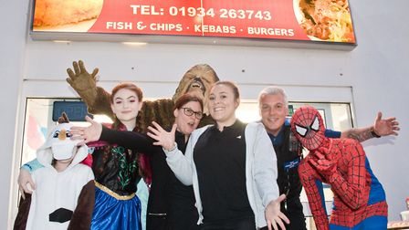 Laura Flanagan and her staff with charty fancy dressers and supporters. Picture: MARK ATHERTON