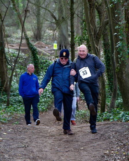 Walkers enjoying the route through Weston Woods.