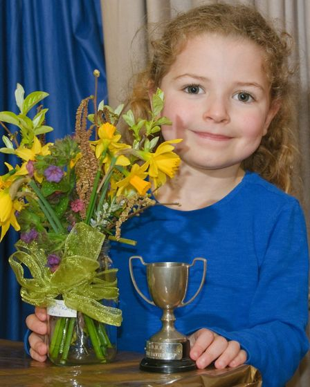 Bleadon Horticultural Society Spring Show, 6-year-old Rosie with her prize winning flower arrangemen
