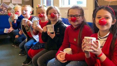 Children from St Anne's Church Academy celebrating Red Nose Day.