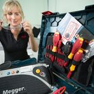A tradeswoman with her Buy With Confidence leaflets. Picture: Tim Pestridge Photography