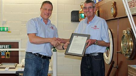 Nearly 40 years on and Mike Buckland presented an award to Richard Spindler to mark his long service