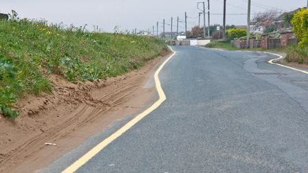 Wonky yellow lines in Beach Road Sand Bay. Picture: MARK ATHERTON