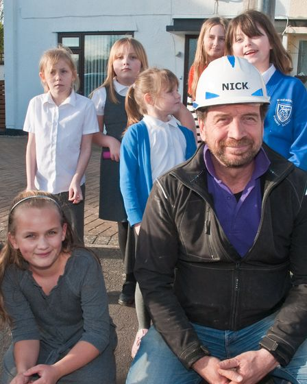 The DIY SOS team and volunteer trades at Exford Close. Picture: MARK ATHERTON