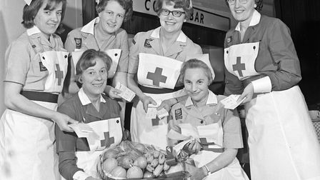 Uniformed nurses who sold tickets for the raffle at the Weston Red Cross Ball, held at the Winter Ga