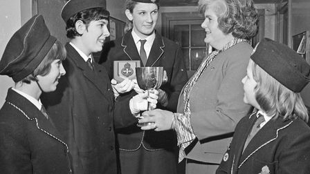 Girls' Brigade member Joyce Salvage receiving an award for first aid from Mrs. E.M. Griggs. Also pic