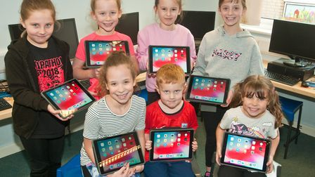 St Francis Primary School children with iPads bought by their PTA. Picture: MARK ATHERTON