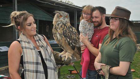 Mum Kristen holding Nyra the european eagle owl with daughter Amelia-Lily 6 and Shane and Jade Jenki