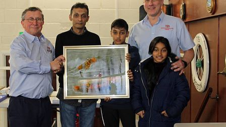 Weston RNLI Lifeboat Operations Manager Mike Buckland presenting an award to Sayd Ahmed of Pappadoms