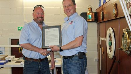 Weston RNLI Lifeboat Operations Manager Mike Buckland presenting an award to Nigel Congram. Picture: