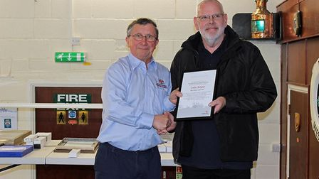 Weston RNLI Lifeboat Operations Manager Mike Buckland presenting an award to John Boyne. Picture: We