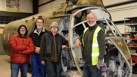 The Flying Banana with the volunteers who will be restoring it. Picture: Helicopter Museum