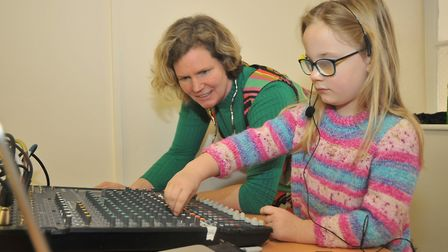 Paua Birtwistle showing 6-year-old Ella how to use a sound desk Terrestrial.Picture: Jeremy Long