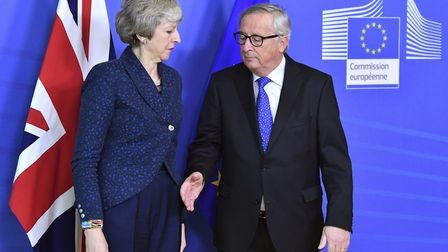 European Commission President Jean-Claude Juncker, right, prepares to shake hands with British Prime