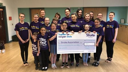 Performers from Next Step Dance Academy handing over their donation to the Stroke Association.