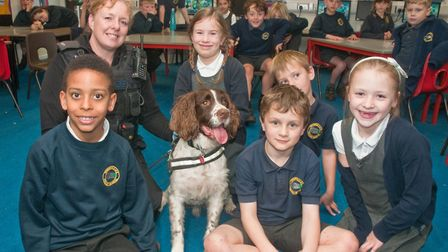 Police officer Louise Grabham and sniffer dog Ollie. Picture: MARK ATHERTON