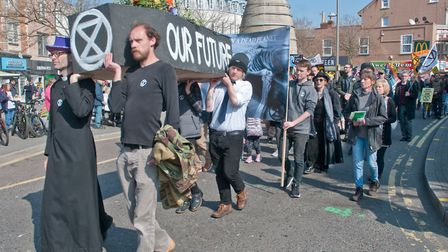 A Extinction Rebellion funeral procession and memorial service to mourn the loss of the life the pl