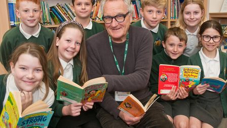 Author Jeremy Strong reading though his books with pupils during a visit to Trinity Primary School.