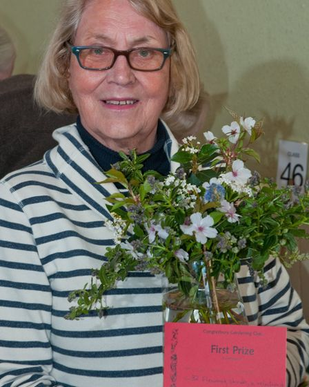 Maggie Bissett with one of her prize winning exhibits at Congresbury Gardening Club Spring show. Pi