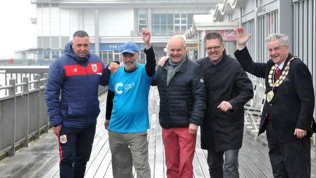 Paul Hobbs walking round pier for five hours to raise money for charity.
