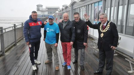 Paul Hobbs walking round pier for five hours to raise money for charity. Joned by Brian Tinnion from