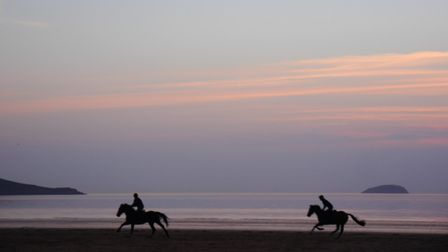 Riders galloping across Westons beach.Picture: Terry Kelly