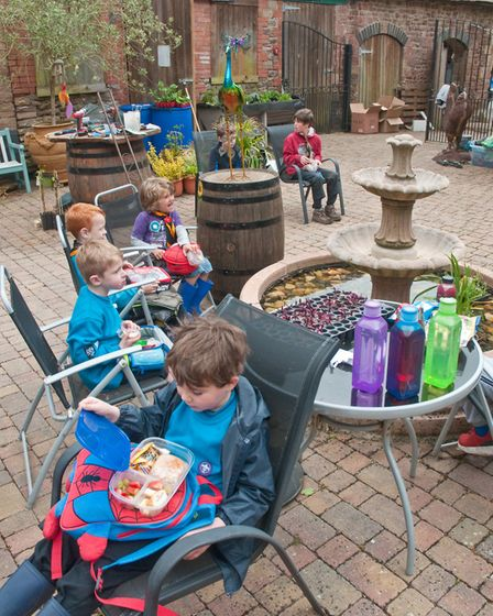 Beavers and Cub Scouts from the Winscombe Pack helping to create a sensory garden at Winscombe Care