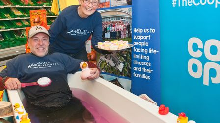 Graham Hunt sitting in a bath of gunk at Worle COOP, pictured with his mum Sandra Hunt who was selli