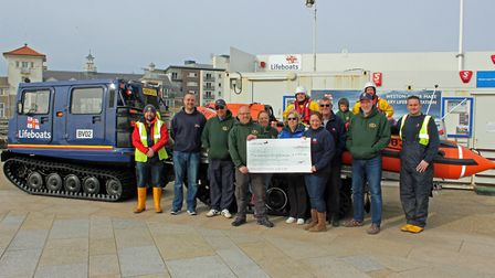 RNLI volunteers accepting the cheque from the Weston Sea Angling Association. Picture: Weston RNLI