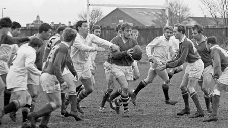 Weston beat Bridgwater to win the Baker trophy. Weston's Phil Anderson gets the ball away to Rod Cro