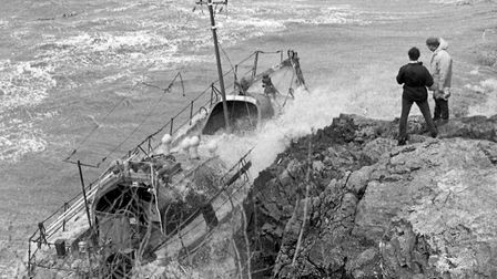 The Weston lifeboat Rachel and Mary Evans being battered by heavy seas as she lies on the rocks near