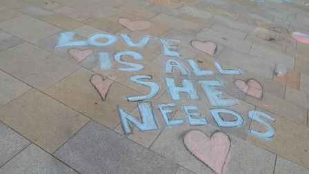 Families and children wrote temporary messages on the Italian Gardens. Picture: Peter Elston