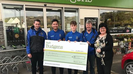 Staff from Tout's Budgens of Nailsea handing over the donation to AFC Nailsea.