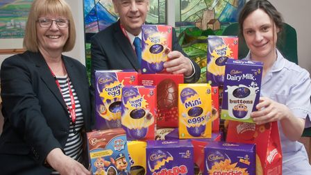 Sonia Royce and Tony Lock of AJ Lock Caring Funerals handing over the easter eggs to Weston Hospicec