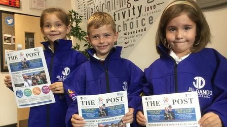 St Annes Church Academy pupils with The Post at their news centre. Picture: WESTON MERCURY