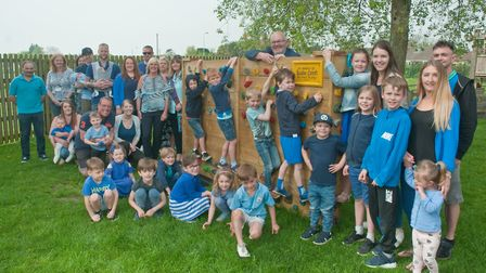 Parents, family, headteacher and Bailee's class mates with the new climbing wall built in his memory