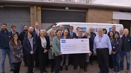Staff from Costain in Yatton handing over the money they have raised to Children's Hospice South Wes