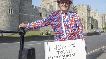 Royal fan Terry Hutt celebrates his 84th birthday outside Windsor Castle in Berkshire as the country