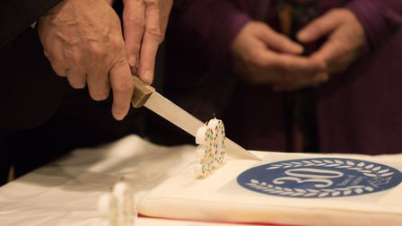 A 30th anniversary cake was cut as part of the celebration.