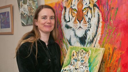 Artist Emma Jane Kimsey with her Big Cat art exhibition at the Blakehay Theatre. Picture: MARK AT
