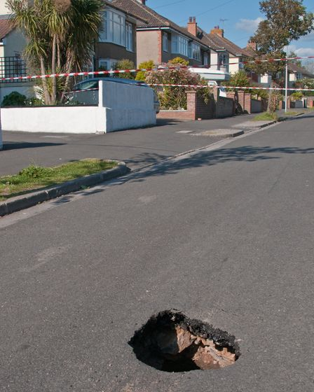 Sink hole in St Nicholas Road, Uphill. Picture: MARK ATHERTON