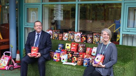 Gordon Veale handing over Easter eggs and more than £5,000 to Above & Beyond.