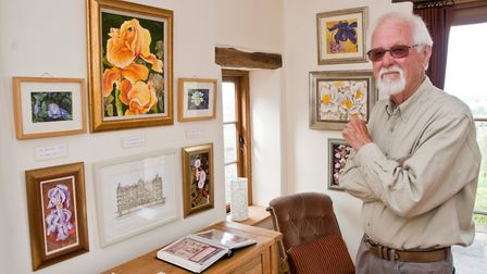 John Hickley exhibiting architectural illustrations from Looking Up Weston, colourful Flower paintin