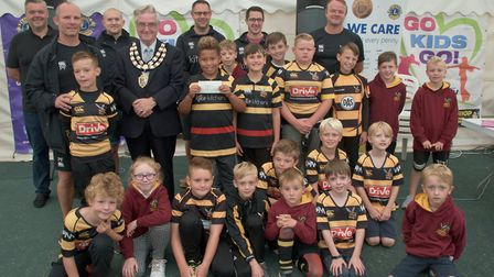 Weston Mayor Cllr Mike Lyall presenting £250 to Hornets Junior Rugby Club.