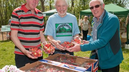 Graham and David serving customer Garry with some strawberries at Winscombe May Fair. Picture: MA