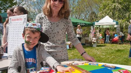 Hazel Sampson with a customer for her wheel of fortune at Winscombe May Fair. Picture: MARK ATHER